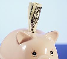 Photo: a dollar bill in a piggy bank