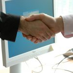 Photo: a handshake in a business setting
