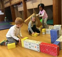 children playing on the floor with blocks
