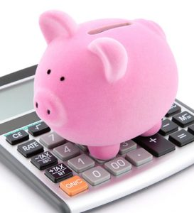 A bright pink piggy bank on top of a calculator