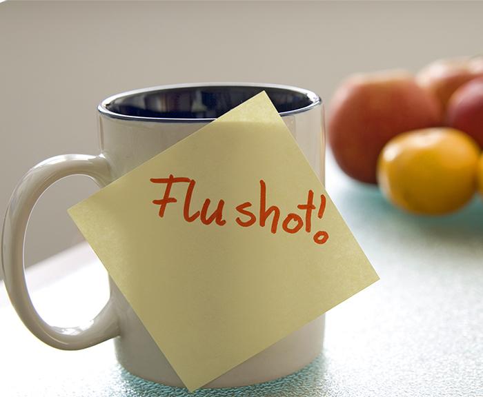 mug with flu shot sticky note
