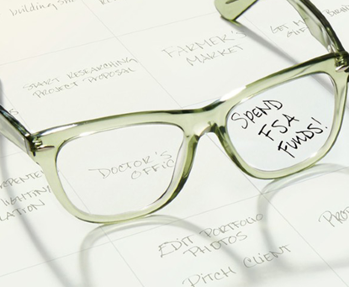 A pair of glasses with spend FSA funds written on them