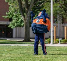 Otto the Orange in a mask on quad